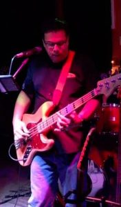 Terry playing bass guitar