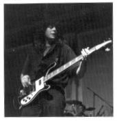 John playing a Rickenbacker bass