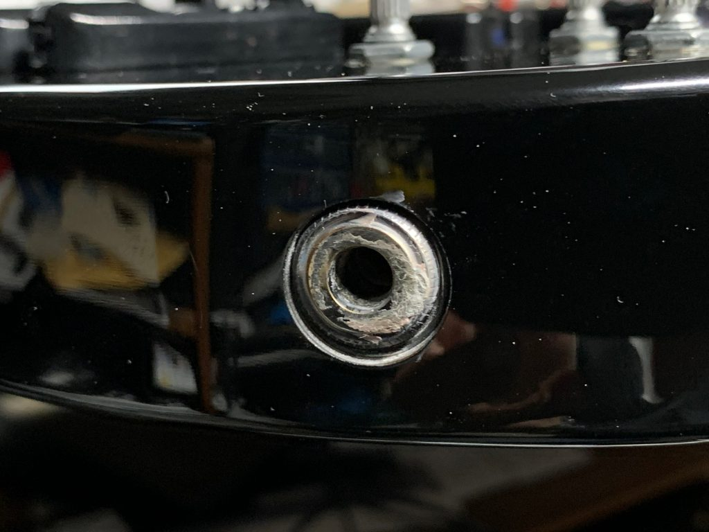 The build up of polishing compound around the output jack.